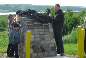 Lorne Topley's son, Ryan, and grandsons, Austin and Mason, Unveil Cairn